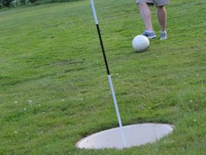 "FootGolf uses a 21"" cup but you play just like golf."